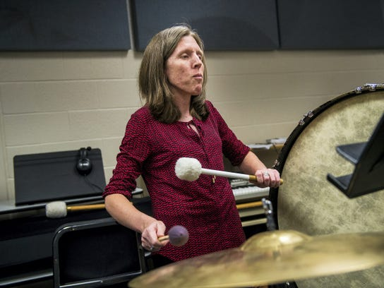 Jill Slagle plays the bass drum during practice at