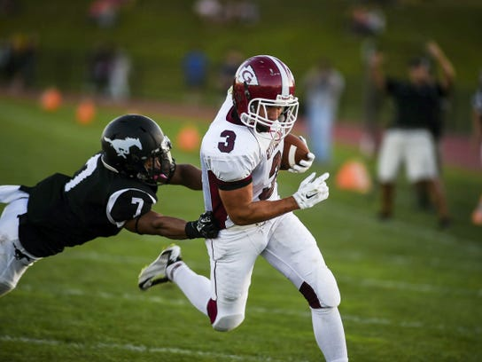 Gettysburg's Nathan Sharrah scores from 15 yards out in the first quarter.
