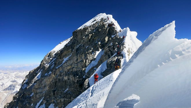 In this May 18, 2013 photo released by mountain guide Adrian Ballinger of Alpenglow Expeditions, climbers navigate the knife-edge ridge just below the Hillary Step on their way to the summit of Mount Everest, in the Khumbu region of the Nepal Himalayas.