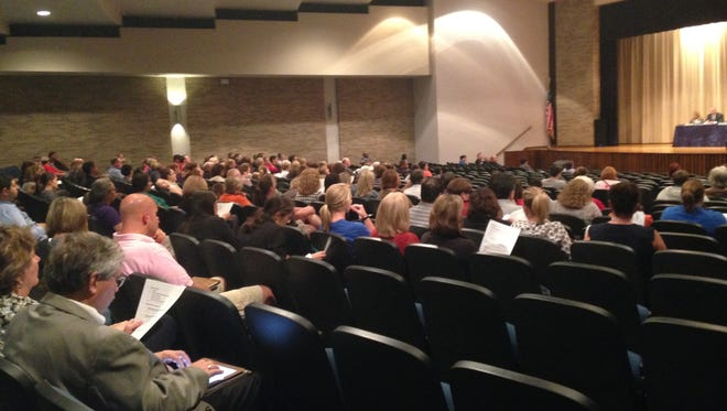 A crowd of more than 200 people attend the Muncie Community School board meeting Oct. 6 at Northside Middle School. Teachers were surprised by the board's decision to switch insurance providers.
