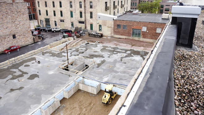 A construction crew works on the foundation for the  new section of Jones421 on Phillips Avenue.