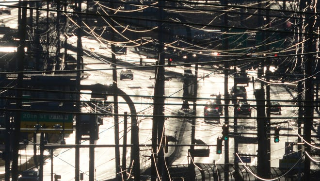 Utility lines and Route 120 in the backlight of the early morning sun. (Tariq Zehawi/@tariqzehawi)