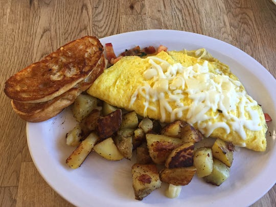 Ham and cheese omelet served with cottage potatoes and toasted franchese breat
