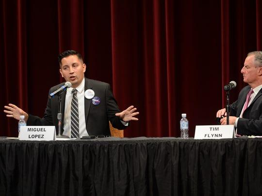 Oxnard mayoral candidate Miguel Lopez, left, speaks