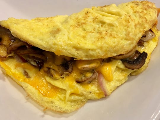 The omelet with mushrooms, cheddar and red onion was excellent.