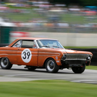 Mike Mulcahy drives his 1964 Ford Falcon (39) out of