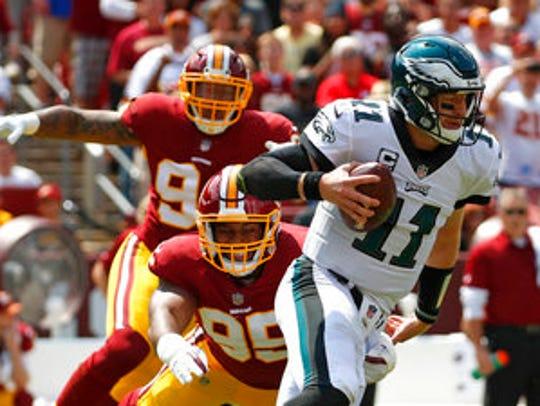 Eagles quarterback Carson Wentz, tries to outrun Washington