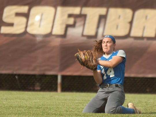 Sterilng's Rebecca Krause catches a fly ball in the