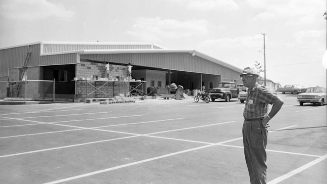 Othel E. Green supervises the reconstruction of the Devils Lake Pavilion in August 1965. That same building exactly 55 years later is in the middle of deconstruction.