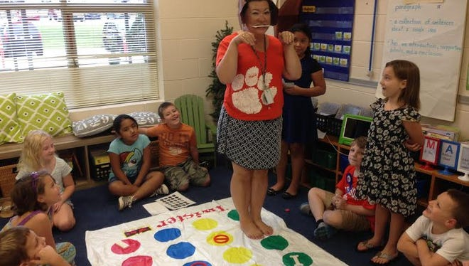 "Shown are second-graders giving computer commands to ""Rosie the dog"" portrayed by Malissa Stephens, a second-grade teacher."