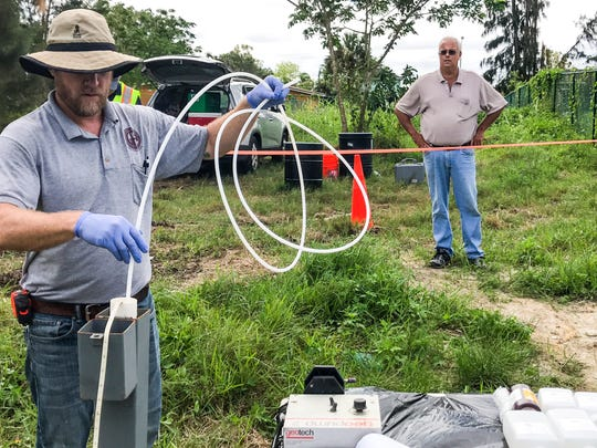 Scott McManus, project leader for the city consultant GFA, drops a small hose down the well first well they are testing. The cityÕs sludge site in Dunbar meets its moment of truth as GFA International begins testing for contaminants based on a bigger, better, DEP-approved plan. Legal counsel and class action clients will be watching as their cases hang on the results. The testing will take place over three days, through Friday, October 20, 2017.
