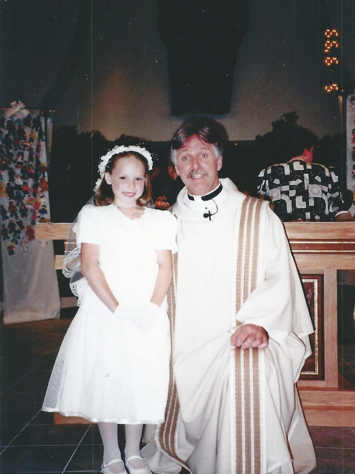 Brittany Sherfield makes her first Holy Communion.