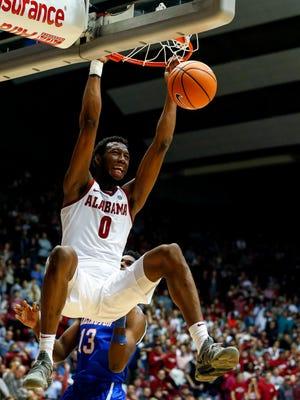 Alabama forward Donta Hall slam dunks against Texas-Arlington