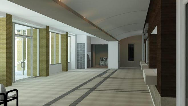 An architectural rendering created by HOK shows a design idea for the reception area of the Wichita County Law Enforcement Center. This is a side view showing the view of the front doors, left, and the reception window, right.