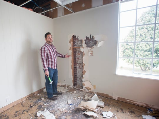 Andrew Fisher, owner of Physician Specialty Pharmacy, tears down drywall on Tuesday, Nov. 22, 2017, to expose the original brick wall at the Greater Pensacola Chamber's former headquarters on West Garden Street in Pensacola. Fisher plans to renovate the building and leave much of the original structure exposed.