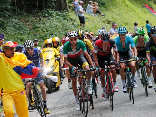 Ireland's Daniel Martin, Italy's Fabio Aru, Slovenia's Primoz Roglic, Australia's Richie Porte, Denmark's Jakob Fuglsang, stage winner Colombia's Rigoberto Uran and Colombia's Nairo Quintana, from left, climb after Britain's Chris Froome encountered a mechanical problem in the climb of the Mont du Chat pass during the ninth stage of the Tour de France cycling race over 181.5 kilometers (112.8 miles) with start in Nantua and finish in Chambery, France, Sunday, July 9, 2017. (AP Photo/Christophe Ena)