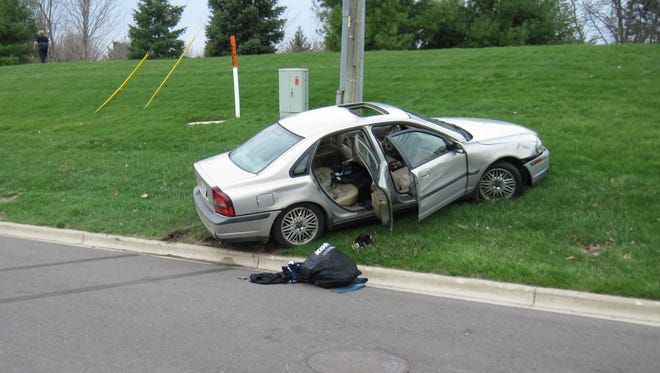 Police said five Washtenaw County residents abanonded this vehicle in the alley behind Kohl's in Green Oak Township after they committed a retail fraud in the store. The merchandise they tried to steal is in the bag on the ground and the back seat, police said.