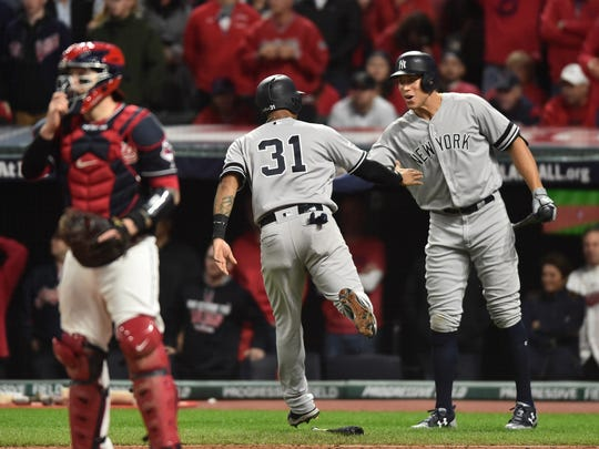 Oct 11, 2017; Cleveland, OH, USA; New York Yankees center fielder Aaron Hicks (31) celebrates with right fielder Aaron Judge (99) after scoring in the ninth inning during game five of the 2017 ALDS playoff baseball series against the Cleveland Indians at Progressive Field.