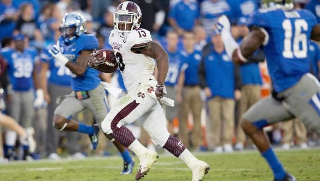 Mississippi State running back Josh Robinson evades Kentucky defenders in his team's win on Oct. 25.