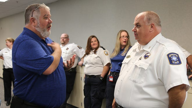 Sudden cardiac arrest survivor Jack Casey, left, talks to Escambia County EMS Deputy Chief of Operations Leon Salter at a ceremony Tuesday, May 22, 2018, at Escambia County Public Safety.