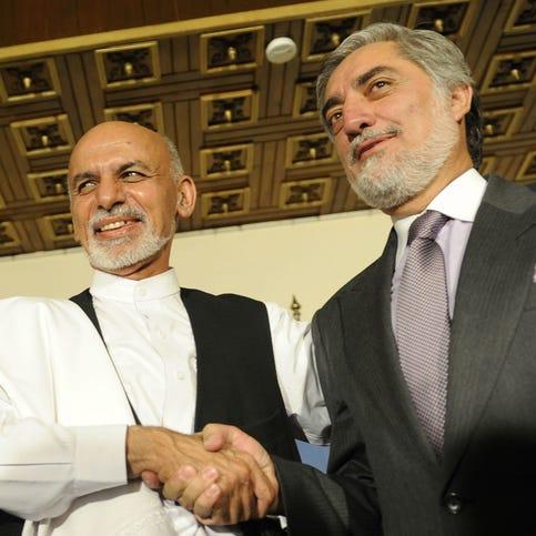 Afghan Presidential candidates Ashraf Ghani Ahmadzai, left, and Abdullah Abdulla