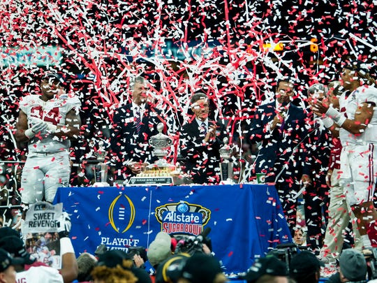 Confetti falls as Alabama is presented the Sugar Bowl trophy following the Sugar Bowl at the Superdome in New Orleans, La. on Monday January 1, 2018. (Mickey Welsh / Montgomery Advertiser)