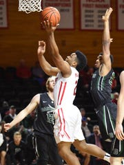 Marist College's Brian Parker flies to the hoop against