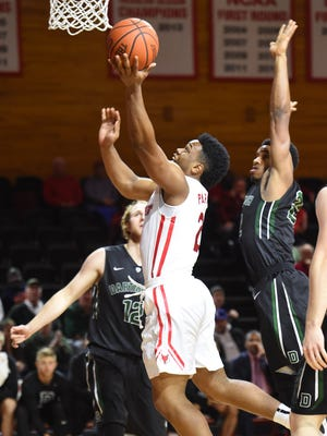 Marist College's Brian Parker flies to the hoop against Dartmouth during a Nov. 17, 2015 game.