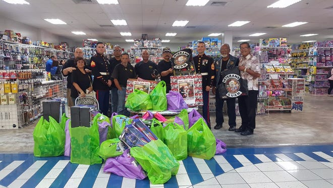 Toys for Tots donation: The Veterans of Guam Motorcycle Club shopped at Toys R Us on Nov. 22, spending over $1,000 on gifts to donate to Toys for Tots. Since 1947, the United States Marine Corps Reserve has distributed toys to children whose parents cannot afford to buy them presents for Christmas. The club participates in this charitable program every holiday season. Sen. Joe S. San Agustin serves as club president. Pictured are club members and Marines at the Micronesia Mall in Dededo.