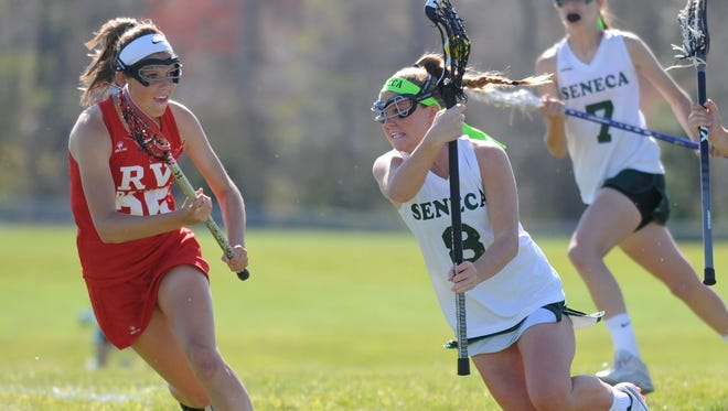 Seneca's Erin Kersetter (right) carries the ball during a game against Rancocas Valley earlier this season. Kerstetter was an All-South Jersey First Team selection.