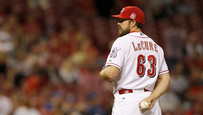 Cincinnati Reds relief pitcher Sam LeCure (63) entered the game for the Reds in the eighth inning during the MLB game between the Cincinnati Reds and the Los Angeles Dodgers, Tuesday, Aug. 25, 2015, at Great American Ball park in Cincinnati, Ohio.