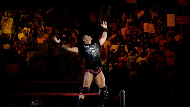 Wrestler Randy Orton poses for the crowd during a live broadcast of a WWE event.