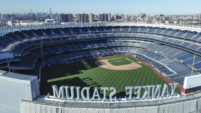 Yankee Stadium remained empty on what was supposed to be Opening Day in March because of coronavirus pandemic. New York Gov. Andrew Cuomo announced Saturday that both the Yankees and Mets would train in New York if and when MLB and its players open their season.