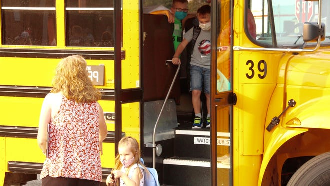Students at Bentheim Elementary hop of the bus for their first day of school Wednesday, Aug. 26.