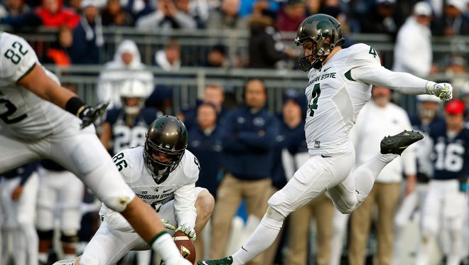 Michigan State kicker Michael Geiger kicks a 28-yard field goal against Penn State during the first half in State College, Pa., Saturday, Nov. 26, 2016.