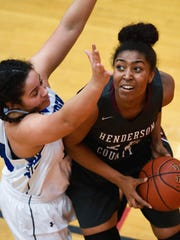 Henderson's Alisha Owens eyes the basket as she matches up with Crittenden's Cassidy Moss as Henderson County plays Crittenden County in the Girls Second Region Tournament at Hopkins County Central Tuesday, February 28, 2017.