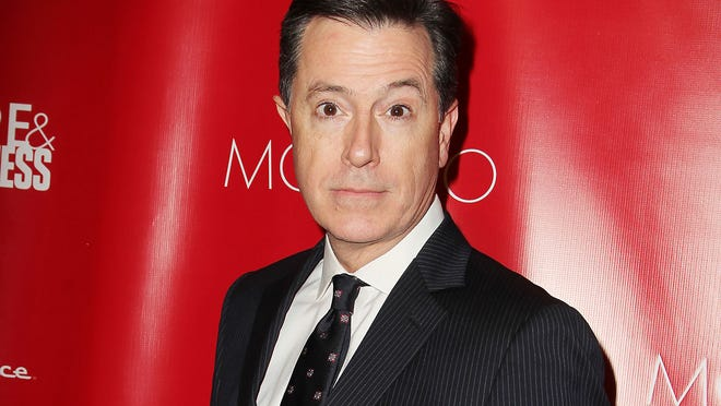 """FILE - This Jan. 31, 2014 file image released by Starpix shows Stephen Colbert at the Shape Magazine and Men's Fitness Super Bowl Party in New York. Colbert will not only be following in David Letterman's footsteps, he'll be doing it on the same stage. CBS said Wednesday, July 23, that Colbert, who is replacing Letterman as the """"Late Show"""" host next year, will keep the show in New York City's Ed Sullivan Theatre. Colbert's debut date is still uncertain, dependent on when Letterman officially retires from late-night TV.  (AP Photo/Starpix, Amanda Schwab, File) ORG XMIT: NYET315"""