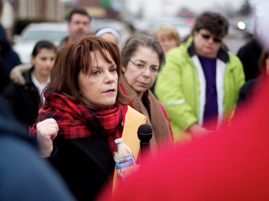 Pro-life activist Lynn Mills (red scarf) speaks in front of the Women's Center of Southfield which the State of Michigan temporary closed as it investigated allegations of unsanitary conditions and state violation.