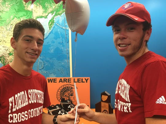 Lely High School's cross country/track runners Cody Demalavez, left, and Josh Wagner celebrate signing with Florida Southern University at a ceremony at the school on April 12.