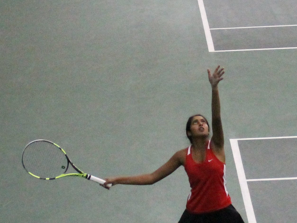 Central No. 1 singles player Meera Singhal serves during a match at the 2016 state tennis tournament on an indoor court at Cooper Tennis Complex.