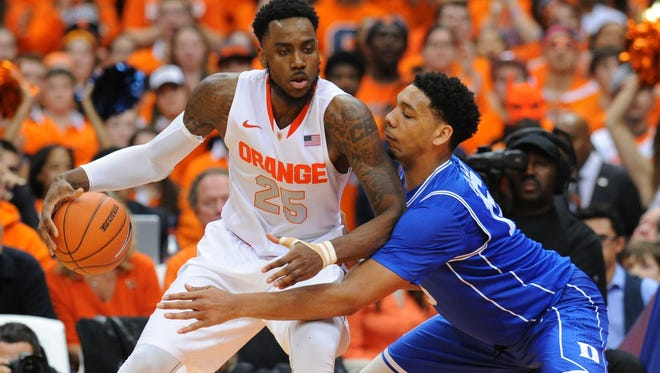 Syracuse forward Rakeem Christmas (25) controls the ball against the defense of Duke center Jahlil Okafor last week at the Carrier Dome.