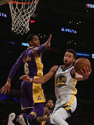 The Golden State Warriors' Stephen Curry shoots against Los Angeles Lakers guard Jordan Clarkson.