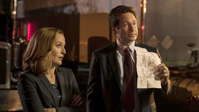 Mulder and Scully investigate a were-monster case on 'The X-Files.'