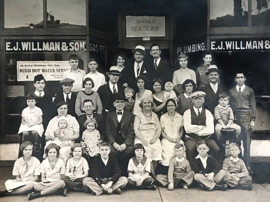 Willman family photo, outside the E.J. Willman & Son plumbing, Circa 1932. Lillian Ruth Willman Ernst is in the center of the photo, directly behind the older woman.