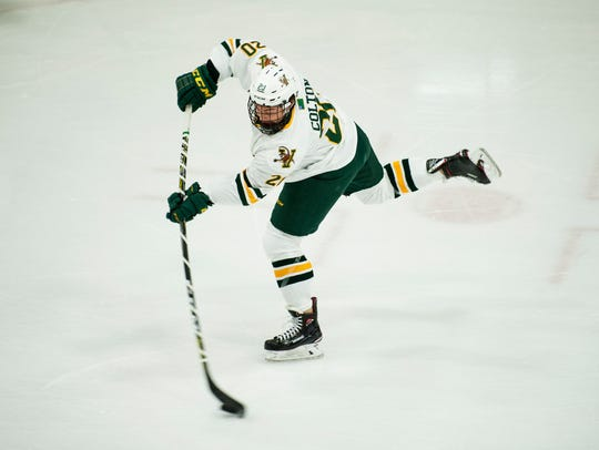 Vermont forward Ross Colton (20) takes a shot during