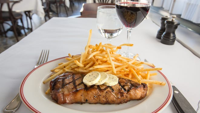 Faux filet, a New York strip steak with french fries and maitre d'hotel butter at Cafe Grace, the French restaurant at the Mayfair Collection, 11200 W. Burleigh St., Wauwatosa.