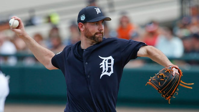 Feb 24, 2017; Lakeland, FL, USA; Tigers starting pitcher Mike Pelfrey  throws a pitch during the second inning of a spring training game against the Orioles at Joker Marchant Stadium.