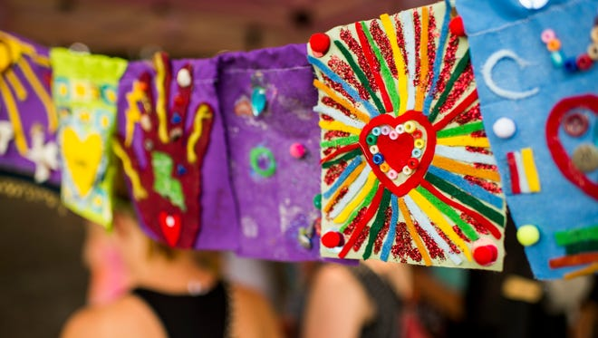 Prayer flags that express solidarity with the Grand Theatre shooting victims are displayed during the final Levitt AMP Lafayette Music Series concert at the Horse Farm in Lafayette, La., Wednesday, July 29, 2015.