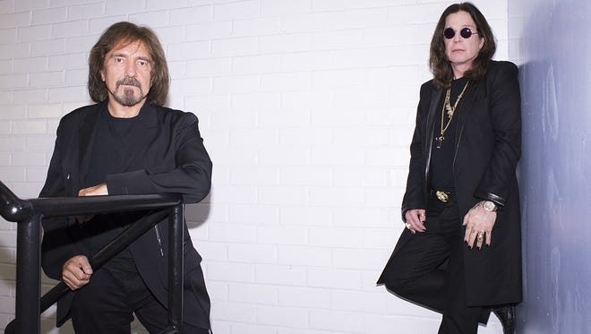 Ozzy Osbourne This June 6, 2013 photo shows singer Ozzy Osbourne, right, and musician Geezer Butler of the rock band Black Sabbath posing for a portrait  in Los Angeles. (Photo by Dan Steinberg/Invision/AP)