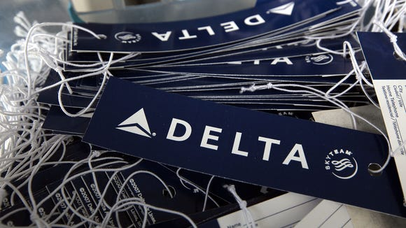 Delta Air Lines luggage tags in a basket at a skycap